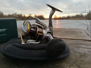 Kastking Kodiak spinning reel on neoprene bag by the water